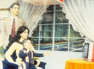 Model Middle Class Family with TV, 1980 store window; An ideal, not reality